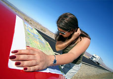 California Roadtrip3. Woman looking at road map Royalty Free Stock Photos