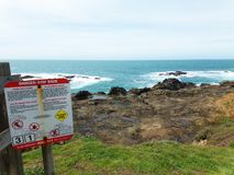 Rocky Shore with a Danger Sign - Road Trip Down Highway 1 Discovery Route Along The California Coast stock image