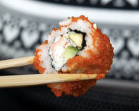 California Roll. Held wooden sticks Stock Photography