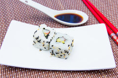 California roll with avocado and surimi on bamboo close Royalty Free Stock Image