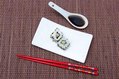 California roll with avocado and surimi on bamboo seen from above Royalty Free Stock Photo