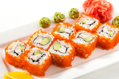California Roll with Masago. California Maki Sushi with Masago  - Roll made of Crab Meat, Avocado, Cucumber inside. Smelt roe outside Stock Photos