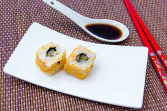 California roll with salmon and mallotto eggs on bamboo seen up close Royalty Free Stock Image