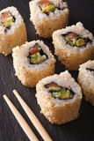 California roll with salmon in sesame macro. Vertical Royalty Free Stock Photo