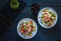 California roll sushi bowls on dark background, top view stock photo