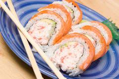 California Rolls. On a blue plate royalty free stock photo
