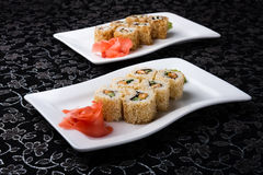 California rolls sushi decorated with pickled ginger Stock Images