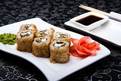 California rolls sushi with pickled ginger, vasabi and soy sauce in the plate Royalty Free Stock Photo
