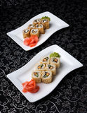 California rolls sushi with pickled ginger, vasabi and soy sauce in the plate Royalty Free Stock Image
