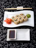 California rolls sushi with pickled ginger, vasabi and soy sauce in the plate Royalty Free Stock Photography