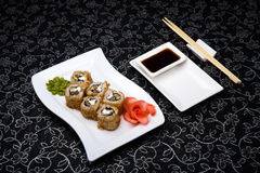 California rolls sushi with pickled ginger, vasabi and soy sauce in the plate Royalty Free Stock Photos