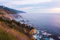California Route 1,  United States. Amazing coastline of California`s Route 1 with beautiful purple sky and ocean. California, United States Royalty Free Stock Photos