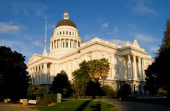 California State Capitol at sunset. With lots of trees around it Stock Photos