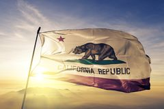 California state of the United States of America flag textile cloth fabric waving on the top. California flag textile cloth fabric waving on the top sunrise mist stock photography