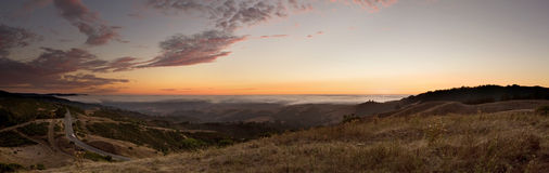 California Sunset Panorama. A sunset looking west, with the Pacific Ocean just beneath the fog. Taken in Northern California Stock Images