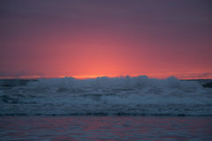 California Sunset. Red and orange sunset behind Pacific Ocean waves royalty free stock photography