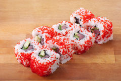 California sushi rolls on wooden plate Stock Image