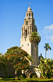 California Tower, Balboa Park, San Diego. The historic sculptured California Tower rises above the Museum of Man building in Balboa Park, San Diego, with palm stock photo