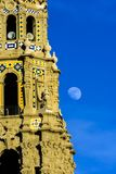 California tower and the moon. The moon rises next to the California tower in Balboa park located in San Diego, California Royalty Free Stock Photo