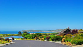 Bodega Bay, skyline, architecture, garden, flowers, California, United States of America, Usa. A road, villas and gardens in Bodega Bay on June 13, 2010. Bodega Royalty Free Stock Photography