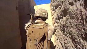 California USA, November 2015, US Soldiers Walk Small Way Between Houses stock video