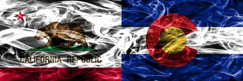 California vs Colorado colorful concept smoke flags placed side. By side stock photography