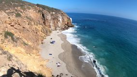 Pirates Cove beach. California West Coast. Panoramic view of Pirates Cove beach, a small cove on west side of Point Dume, Malibu coast, United States. Blue sky stock footage