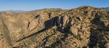 California Wilderness National Forest Desert. California Angeles National Forest hilltops and rock boulders among desert hills Royalty Free Stock Photography