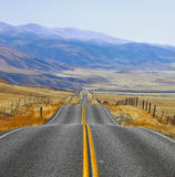 The Californian prairie , road and fencings Royalty Free Stock Images