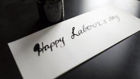 Caligrafía de trabajo feliz del día del ` s y postal lattering Visión izquierda Imagen de archivo