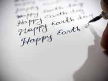 Caligrafía feliz del Día de la Tierra y el lattering Imagen de archivo