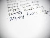 Caligrafía feliz del Día de la Tierra y el lattering Foto de archivo libre de regalías