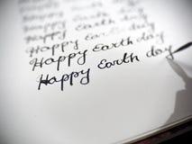 Caligrafía feliz del Día de la Tierra y el lattering Fotografía de archivo libre de regalías