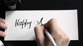 Caligrafía feliz del día del ` s de la madre y postal lattering Visión superior almacen de video