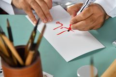 Caligrafía o letras decorativas de la escritura imagenes de archivo