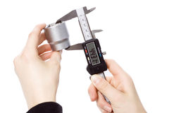 Caliper. Electronic caliper use in hands royalty free stock photos
