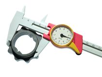 Caliper. Measurement of mechanical piece, isolated over white stock images