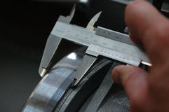 Caliper. Measuring a tool with a caliper Stock Image