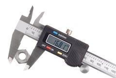 Caliper. Digital caliper with nut isolated on white stock photo