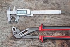 Caliper and adjustable wrench. Stock Images