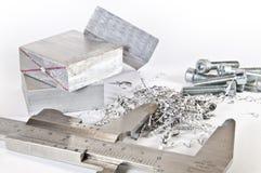 Caliper with aluminium, cuttings and screws Stock Image