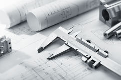 Caliper on blueprint. Caliper and machine parts on mechanical blueprint Royalty Free Stock Photography