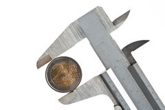 Caliper with euro coin Stock Photography