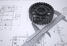 Caliper and gear in the drawing Royalty Free Stock Photos