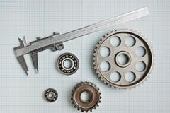 Caliper with gears and bearings. On graph paper royalty free stock photos