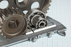Caliper with gears and bearings. On graph paper royalty free stock image