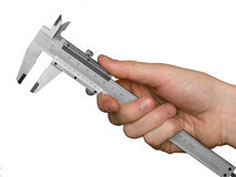 Caliper in hand Stock Images