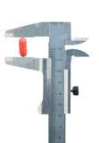 Caliper measure pill Stock Image