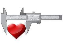 Caliper measures heart Royalty Free Stock Photography