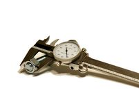 Caliper Measuring the Nut. Dial caliper measuring the nut Royalty Free Stock Photo